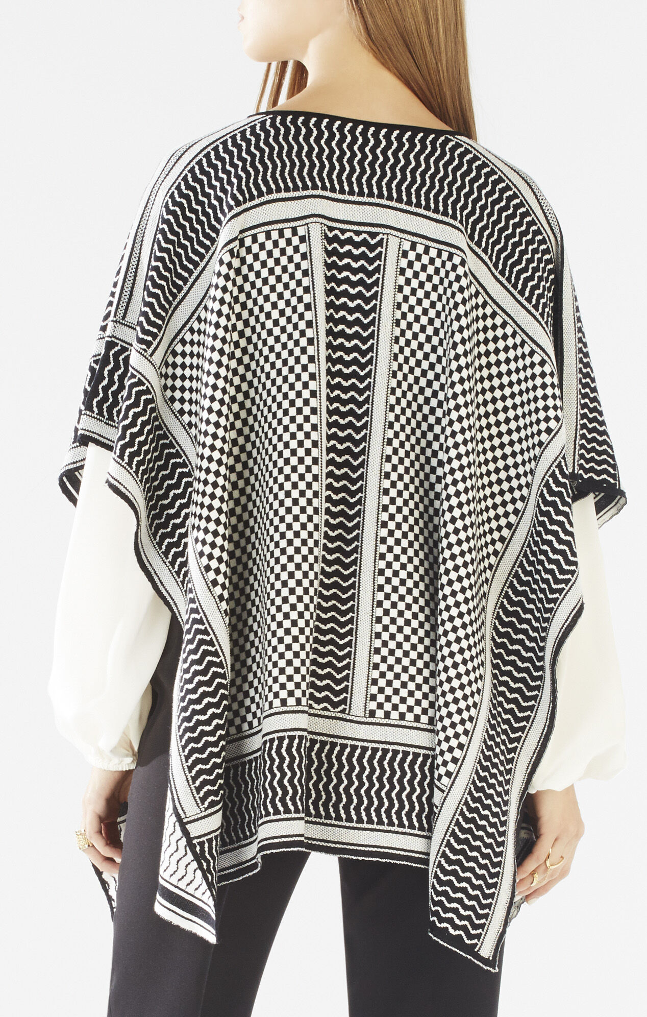 With a high neck and cable knit designs, this poncho sweater is perfect for the holiday season.
